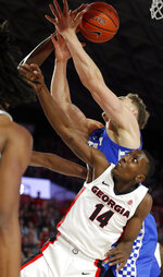 Kentucky forward Reid Travis (22) and Georgia guard Tye Fagan (14) battle for a rebound during the second half of an NCAA college basketball game Tuesday, Jan. 15, 2019, in Athens, Ga. Kentucky won 69-49. (AP Photo/John Bazemore)