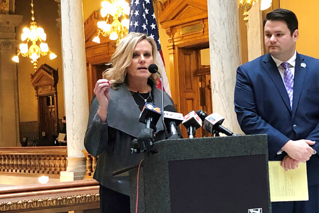Republican Indiana Superintendent of Public Instruction Jennifer McCormick speaks during a news conference with state Sen. J.D. Ford, D-Indianapolis, on Friday, Jan. 3, 2020, at the Statehouse in Indianapolis, in support of a bill that would ban private schools that discriminate against gay employees and students from receiving money from Indiana's voucher program. (AP Photo/Tom Davies)