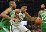 Milwaukee Bucks' Giannis Antetokounmpo tries to drive past Boston Celtics' Al Horford during the first half of Game 5 of a second round NBA basketball playoff series Wednesday, May 8, 2019, in Milwaukee. (AP Photo/Morry Gash)