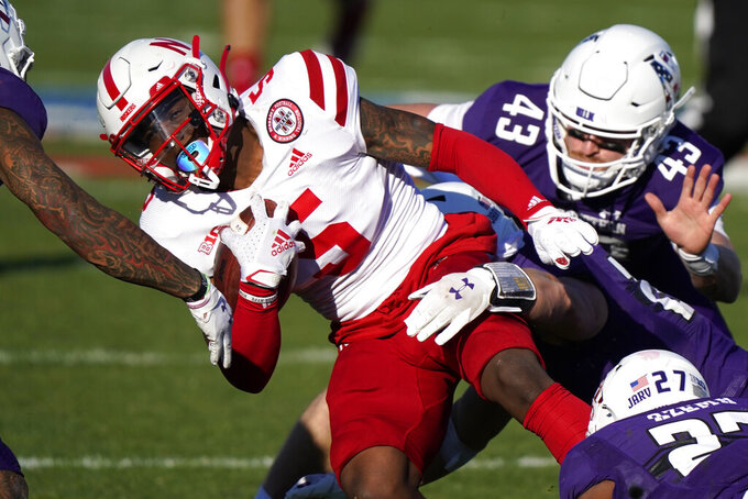 FILE - Nebraska wide receiver Omar Manning (5) is tackled by Northwestern defenders during the second half of an NCAA college football game in Evanston, Ill., in this Saturday, Nov. 7, 2020, file photo. Manning has had a strong spring and shown flashes of 2019 when he was the top junior college receiver in the nation. (AP Photo/Nam Y. Huh, File)