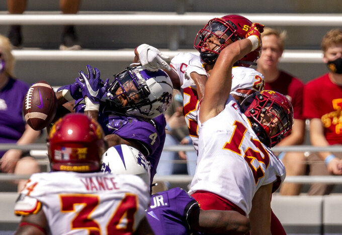 TCU wide receiver Taye Barber (4) is unable to catch a pass as Iowa State defensive backs Anthony Johnson Jr. (26) and Greg Eisworth II (12) defend during an NCAA college football game on Saturday, Sept. 26, 2020 in Fort Worth, Texas. (AP Photo/Brandon Wade)