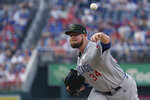 Chicago Cubs starting pitcher Jon Lester throws during the first inning of the team's baseball game against the Washington Nationals, Saturday, May 18, 2019, in Washington. (AP Photo/Andrew Harnik)