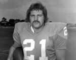 FILE - In this Aug. 9, 1972, file photo, Miami Dolphins running back Jim Kiick poses for a photo.  Former running back Kiick, who helped the Dolphins achieve the NFL's only perfect season in 1972, has died at age 73. In recent years Kiick battled memory issues and lived in an assisted living home, and the team announced his death Saturday, June 20, 2020. (AP Photo/File)