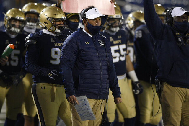 Navy head coach Ken Niumatalolo watches from the sidelines during the first half of an NCAA college football game against Tulsa, Saturday, Dec. 5, 2020, in Annapolis, Md. (AP Photo/Nick Wass)