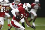 Arizona Cardinals running back David Johnson runs with the ball during NFL football training camp Wednesday, July 31, 2019, in Glendale, Ariz. (AP Photo/Ross D. Franklin)