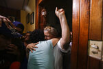 Opposition member María Adilia Peralta Cerratos is embraced by her mother Mariela Cerratos, right, during her return home after being in prison, in Masaya, Nicaragua, Monday, May 20, 2019. Peralta Cerratos is one of 100 prisoners the Nicaraguan government released Monday in a form of house arrest, including three human rights activists. (AP Photo/Alfredo Zuniga)