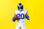 This undated graphic image released by the Los Angeles Rams NFL football team shows a model in their 'bone' uniform color scheme. The Rams have unveiled new uniforms ahead of their move into SoFi Stadium this year. (Los Angeles Rams via AP)