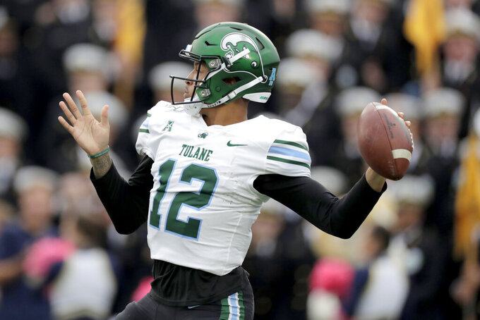 Tulane quarterback Justin McMillan throws a pass against Navy during the first half of an NCAA college football game, Saturday, Oct. 26, 2019, in Annapolis. (AP Photo/Julio Cortez)