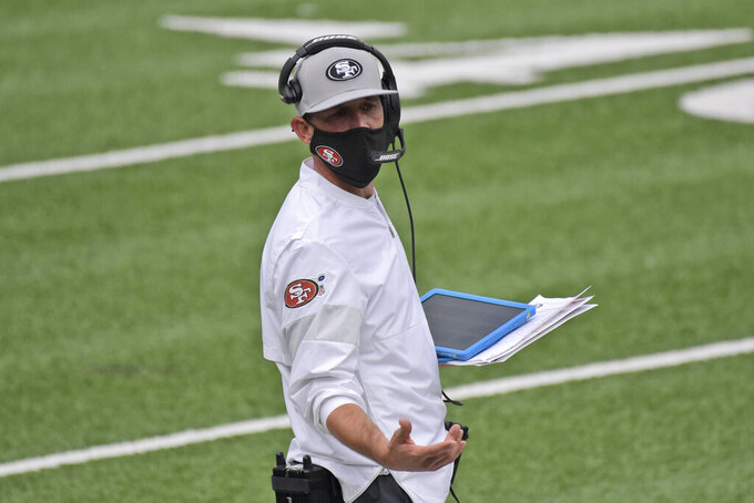 San Francisco 49ers head coach Kyle Shanahan works on the sidelines during the second half of an NFL football game against the New York Giants, Sunday, Sept. 27, 2020, in East Rutherford, N.J. (AP Photo/Bill Kostroun)