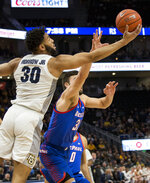 Marquette forward Ed Morrow, left, reaches for the loose ball against DePaul during the first half of an NCAA college basketball game, Wednesday, Jan. 23, 2019, in Milwaukee. (AP Photo/Darren Hauck)