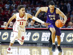 TCU's Kenrich Williams (34) drives the ball away from Oklahoma's Trae Young (11) during the first half of an NCAA college basketball game in Norman, Okla., Saturday, Jan. 13, 2018. (AP Photo/Garett Fisbeck)