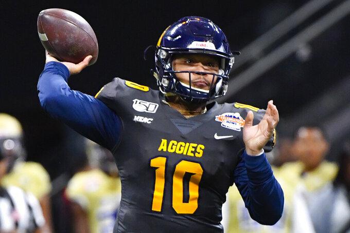 North Carolina A&T quarterback Kylil Carter (10) passes during first half of the Celebration Bowl NCAA college football game against Alcorn State, Saturday, Dec. 21, 2019, in Atlanta. (John Amis/Atlanta Journal-Constitution via AP)