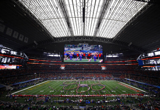 The Clemson marching band performs at AT&T Stadium before the first half of the NCAA Cotton Bowl semi-final playoff football game against Notre Dame on Saturday, Dec. 29, 2018, in Arlington, Texas. (AP Photo/Roger Steinman)