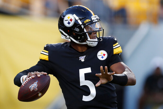Pittsburgh Steelers quarterback Joshua Dobbs throws a pass during the fist half of the team's NFL preseason football game against the Tampa Bay Buccaneers in Pittsburgh, Friday, Aug. 9, 2019. (AP Photo/Keith Srakocic)