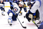 Buffalo Sabres forward Marcus Johansson (90) and Winnipeg Jets forward Cody Eakin (20) take a faceoff during the second period of an NHL hockey game Sunday, Feb. 23, 2020, in Buffalo, N.Y. (AP Photo/Jeffrey T. Barnes)