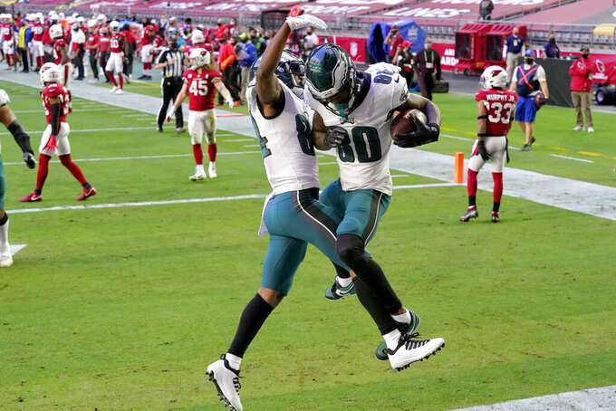 Philadelphia Eagles wide receiver Quez Watkins (80) celebrates his touchdown with wide receiver Greg Ward (84) against the Arizona Cardinals during the first half of an NFL football game, Sunday, Dec. 20, 2020, in Glendale, Ariz. (AP Photo/Ross D. Franklin)
