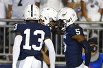 Penn State tight end Brenton Strange (86) celebrates his touchdown with Jahan Dotson (5) during the first half of an NCAA college football game against Auburn in State College, Pa., on Saturday, Sept. 18, 2021. (AP Photo/Barry Reeger)