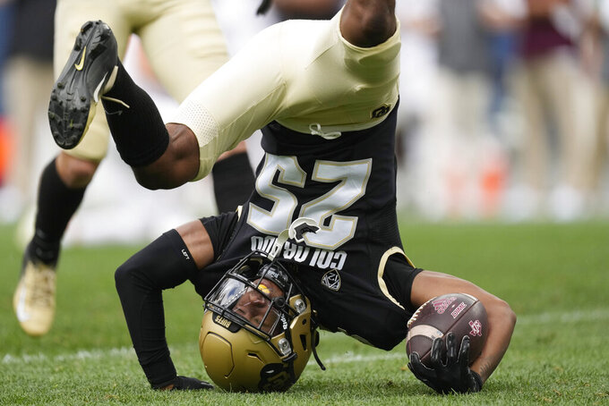 Colorado cornerback Nikko Reed ends up on his helmet in the second half of an NCAA college football game against Texas A&M, Saturday, Sept. 11, 2021, in Denver. Texas A&M won 10-7. (AP Photo/David Zalubowski)