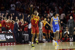 Southern California guard Jonah Mathews (2) runs back after making a game-winning 3-point basket over UCLA forward Jalen Hill (24) as time expired during the second half of an NCAA college basketball game Saturday, March 7, 2020, in Los Angeles. (AP Photo/Marcio Jose Sanchez)