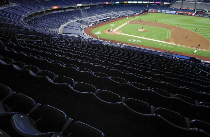 Stands are empty of spectators in the fourth inning of a baseball game between the New York Yankees and the Boston Red Sox, Saturday, Aug. 1, 2020, in New York. (AP Photo/John Minchillo)