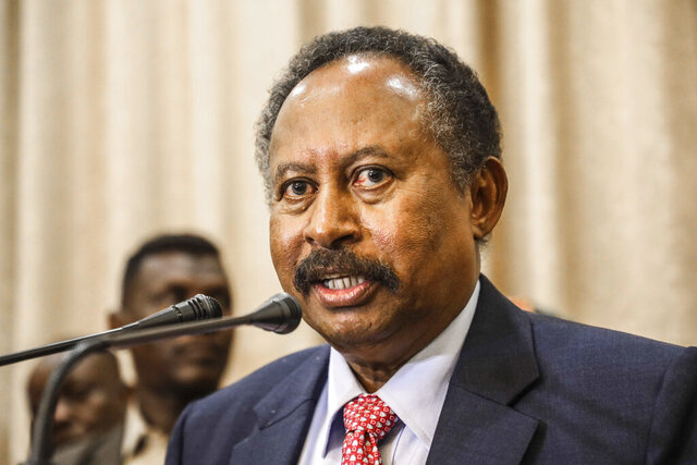 FILE - In this Aug. 21, 2019 file photo, Sudanese Prime Minister Abdalla Hamdok speaks during a press conference in Khartoum, Sudan. On Thursday, Oct. 29, 2020, the Sudanese news agency said Hamdok's senior advisor, Al-Sheikh Khedr, his office manager, Ali Bakheet, and the governor of the Central Bank Mohamed Alfatih Zain Alabdeen have tested positive for the coronavirus. (AP Photo, File)