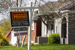 FILE - This Monday, April 27, 2020, file photo shows a sale pending sign on a home in Mount Lebanon, Pa. The coronavirus pandemic helped shape the housing market by influencing everything from the direction of mortgage rates to the inventory of homes on the market to the types of homes in demand and the desired locations. (AP Photo/Gene J. Puskar, File)