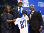 Tennessee State University President Glenda Glover, left, and Athletic Director Mikki Allen, right, announce former NFL running back Eddie George, center, as the schools new NCAA college football head coach during a press conference in Nashville, Tuesday, April 13, 2021. (George Walker/The Tennessean via AP)