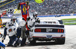 Driver Brad Keselowski's pit crew service his car during a NASCAR Cup auto race at Texas Motor Speedway, Sunday, March 31, 2019, in Fort Worth, Texas. (AP Photo/Randy Holt)