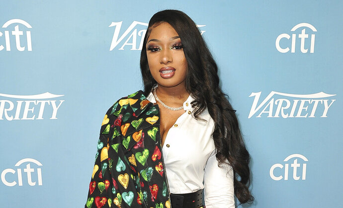 FILE - In this Dec. 7, 2019, file photo, Megan Thee Stallion attends Variety's Hitmakers Brunch in West Hollywood, Calif. In an Instagram Live video Thursday, Aug. 20, 2020, hip-hop star Megan Thee Stallion said for the first time that fellow rapper Tory Lanez was the person who pulled the trigger when she was shot in the feet after a party in the Hollywood Hills more than a month earlier. (Photo by Richard Shotwell/Invision/AP, File)