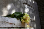 In this photo taken on Monday, June 22, 2020, flowers are left at a plinth on which a bust of Belgium's King Leopold II was removed after being vandalized in Halle, Belgium. In Halle, a small trading town of 40,000, as across much of Europe, the tide is turning and a new consciousness is taking shape in the wake of the Black Lives Matter movement in the United States. (AP Photo/Virginia Mayo)