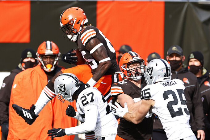 Cleveland Browns tight end David Njoku (85) leaps after a pass reception during the first half of an NFL football game against the Las Vegas Raiders, Sunday, Nov. 1, 2020, in Cleveland. (AP Photo/Ron Schwane)