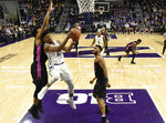 Northwestern guard Anthony Gaines, center, goes to the basket as Penn State forward Lamar Stevens, left, defends him during the first half of an NCAA college basketball game Monday, Feb. 4, 2019, in Evanston, Ill. (AP Photo/David Banks)