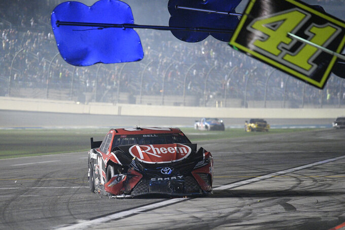 Christopher Bell (20) drives along pit road after getting involved in a multi-car collision during a NASCAR Cup Series auto race at Daytona International Speedway, Saturday, Aug. 28, 2021, in Daytona Beach, Fla. (AP Photo/Phelan M. Ebenhack)