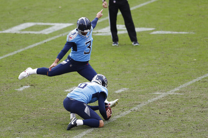 Tennessee Titans kicker Stephen Gostkowski (3) attempts a 45-yard field goal against the Pittsburgh Steelers as Brett Kern (6) holds in the final seconds of the fourth quarter of an NFL football game Sunday, Oct. 25, 2020, in Nashville, Tenn. Gostkowski missed the kick and the Steelers won 27-24. (AP Photo/Wade Payne)