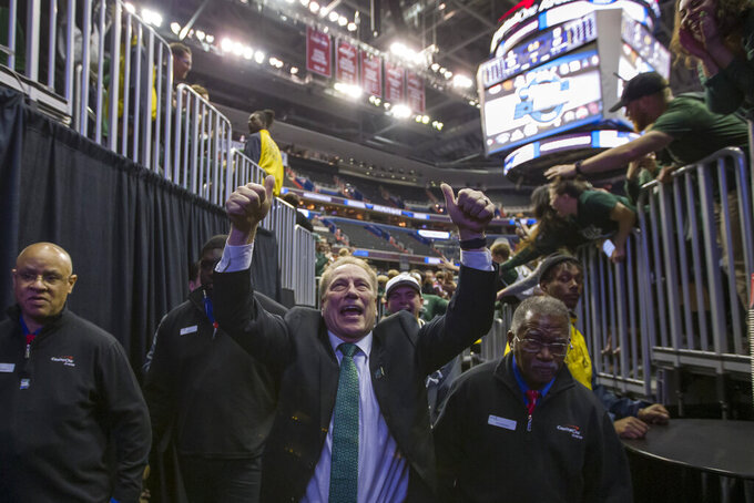 Michigan State head coach Tom Izzo celebrates as he comes off the court after an NCAA men's East Regional final college basketball game against Duke in Washington, Sunday, March 31, 2019. Michigan State won 68-67. (AP Photo/Alex Brandon)