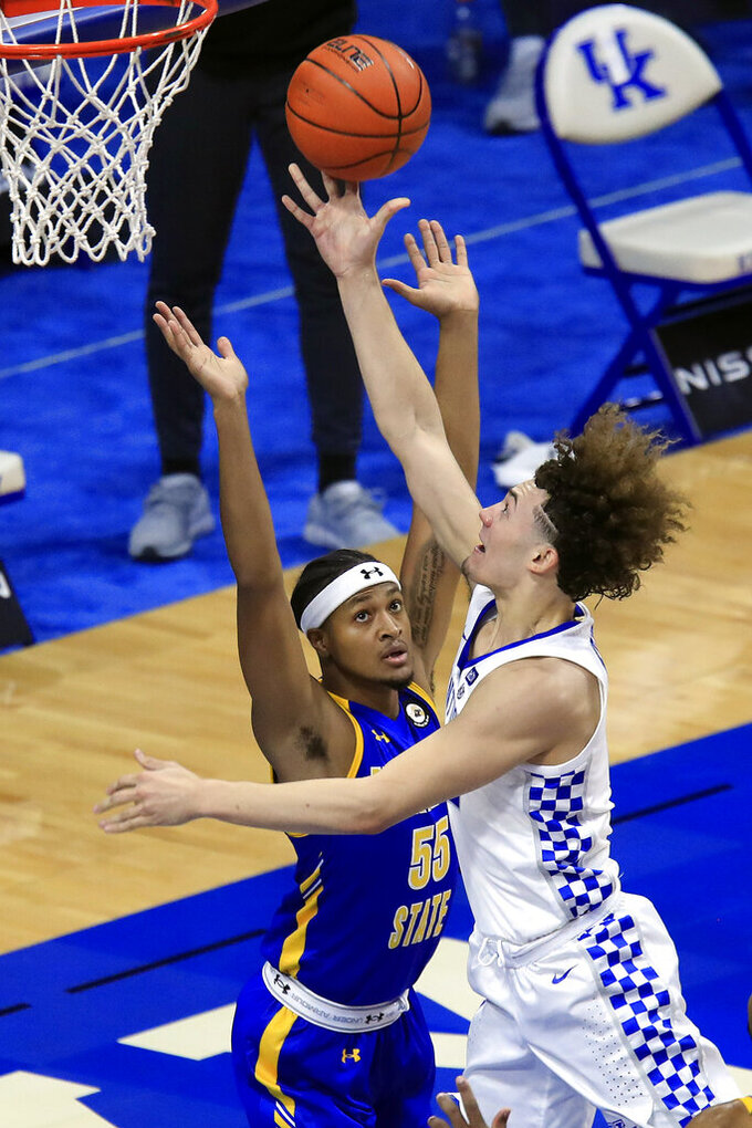 Kentucky's Devin Askew, right, shoots while defended by Morehead State's Ta'lon Cooper during the first half of an NCAA college basketball game in Lexington, Ky., Wednesday, Nov. 25, 2020. (AP Photo/James Crisp)