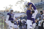 Northwestern wide receiver Riley Lees (19) celebrates with teammate Nik Urban (66) while quarterback Aidan Smith (11) looks on after Lees caught a touchdown pass during the second half of an NCAA college football game against Purdue Saturday, Nov. 9, 2019, in Evanston, Ill. Purdue won 24-22. (AP Photo/Paul Beaty)