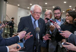 Democratic presidential candidate, Sen. Bernie Sanders, I-Vt., talks to reporters just after the start of the impeachment trial of President Donald Trump on charges of abuse of power and obstruction of Congress, at the Capitol in Washington, Thursday, Jan. 16, 2020. (AP Photo/J. Scott Applewhite)