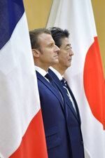 French President Emmanuel Macron, left, and Japanese Prime Minister Shinzo Abe review and honor guard prior to their meeting at Abe's official residence, Wednesday, June 26, 2019, in Tokyo. Macron will attend the G20 Osaka Summit which will be held on June 28th and 29th in Osaka. (David Mareuil/Pool Photo via AP)