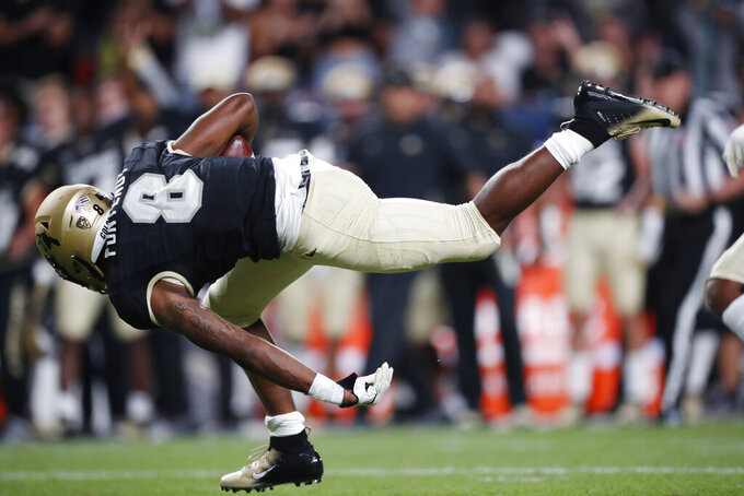 Colorado running back Alex Fontenot is tripped after a long gain against Colorado State in the first quarter of an NCAA college football game Friday, Aug. 30, 2019, in Denver. (AP Photo/David Zalubowski)