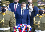 French President Emmanuel Macron takes part at a wreath laying ceremony at the Antakalnis Memorial Cemetery for the people who died in the battle of independence in Vilnius, Lithuania, Tuesday, Sept. 29, 2020. During a visit to Lithuania, Macron met on Tuesday with Sviatlana Tsikhanouskaya, the main opponent of Belarus President Alexander Lukashenko. (AP Photo/Mindaugas Kulbis)