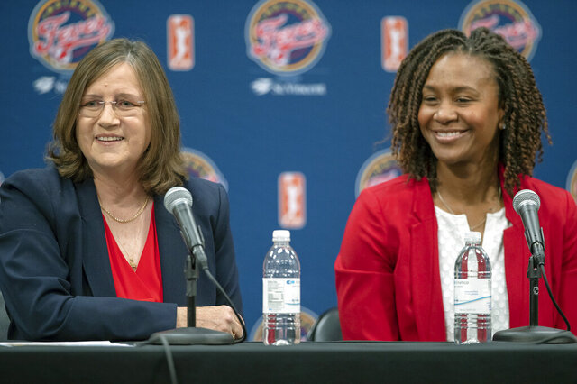 New Indiana Fever WNBA basketball team head coach Marianne Stanley, left,  speaks to the media as Fever vice president of basketball operations Tamika Catchings looks on during a press conference at Bankers Life Fieldhouse in Indianapolis, Tuesday, Nov. 26, 2019. (Mykal McEldowney/The Indianapolis Star via AP)