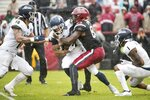 South Carolina wide receiver Bryan Edwards (89) tackles Akron cornerback Darian Dailey (24) during the second half of an NCAA college football game Saturday, Dec. 1, 2018, in Columbia, S.C. South Carolina defeated Akron 28-3. (AP Photo/Sean Rayford)