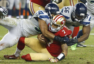 Colin Kaepernick, K.J. Wright, Cliff Avril