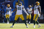 Green Bay Packers outside linebacker Preston Smith celebrates after sacking Los Angeles Chargers quarterback Philip Rivers during the first half of an NFL football game Sunday, Nov. 3, 2019, in Carson, Calif. (AP Photo/Marcio Jose Sanchez)