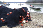 In this Feb. 5, 2020, photo, nets are stored on the shore during a roundup of Asian carp in Smith Bay on Kentucky Lake near Golden Pond, Ky. The work is part of a 15-year battle to halt the advance of the invasive Asian carp, which threaten to upend aquatic ecosystems, starve out native fish and wipe out endangered mussel and snail populations along the Mississippi River and dozens of tributaries. (AP Photo/Mark Humphrey)