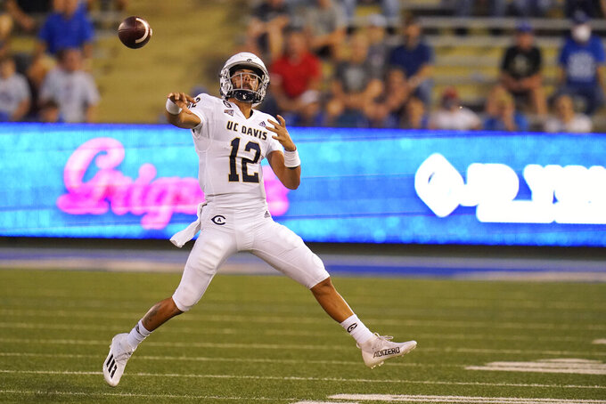 UC Davis quarterback Hunter Rodrigues (12) throws during the team's NCAA college football game against Tulsa, Thursday, Sept. 2, 2021, in Tulsa, Okla. (AP Photo/Sue Ogrocki)
