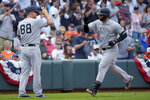 New York Yankees designated hitter Gary Sanchez (24) celebrates with third base coach Phil Nevin (88) after hitting a home run during the ninth inning of the team's baseball game against the Baltimore Orioles, Sunday, April 7, 2019, in Baltimore. (AP Photo/Will Newton)