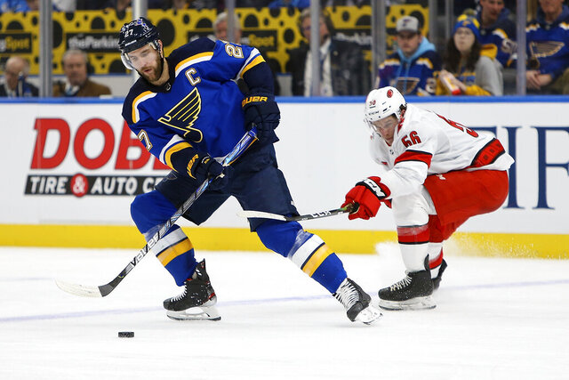 St. Louis Blues' Alex Pietrangelo (27) handles the puck in front of Carolina Hurricanes' Erik Haula (56), of Finland, during the second period of an NHL hockey game Tuesday Feb. 4, 2020, in St. Louis. (AP Photo/Scott Kane)