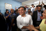 Greek Prime Minister and Syriza party leader Alexis Tsipras greets supporters at a polling station in Athens, on Sunday, July 7, 2019. Greeks are voting in the first parliamentary election since their country emerged from three successive international bailouts but is still struggling to emerge from a crippling nearly decade-long financial crisis. (AP Photo/Yorgos Karahalis)
